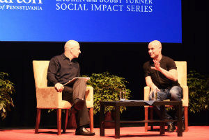 Andre Agassi and Bobby Turner sit on a stage in conversation