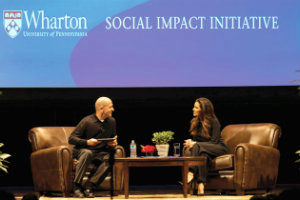Eva Longoria and Bobby Turner sit on stage, in conversation
