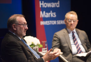 Howard Marks and Seth Klarman sit on a stage, in discussion