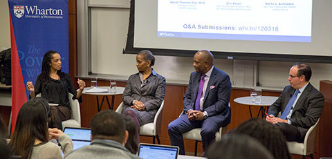Professor Stephanie Creary in conversation with three alumni panelists - one african-american woman, one african-american man and one Caucasian man