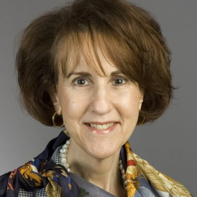 Charlene Barshefsky headshot, wearing a multicolored silk scarf and black and white checkered blazer